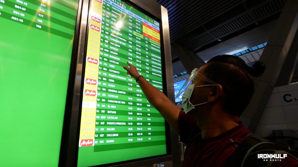 Checking the boarding time at NAIA Terminal 3