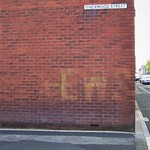 Wartime relics in Preston (look closely)- fading EWS sign