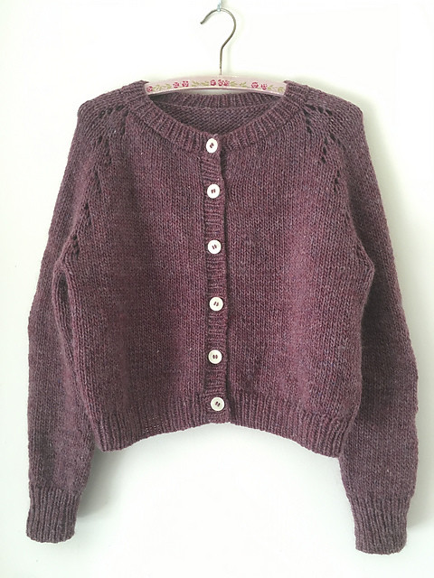 Felix Cardigan by Amy Christoffers is a cropped top down raglan cardigan with an eyelet motif in the raglan increases.