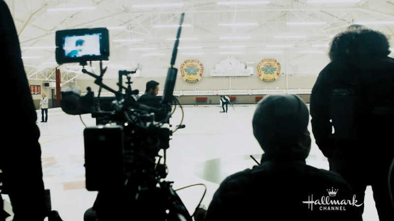 The cast in the curling rink