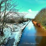 Cottam, near Preston, Lancashire. The Lancaster canal with sunshine and snow.
