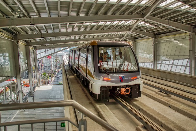 BTS Gold Line People Mover leaving ICON SIAM station in Bangkok, Thailand