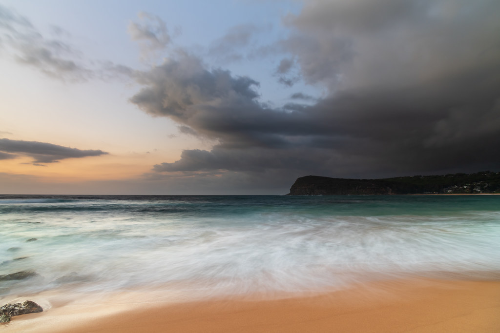 Sunrise at the seaside with rain clouds rolling in