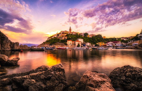 krk croatia vrbnik town hrvatska republicofcroatia republikahrvatska primorjegorskikotar religiousbuilding building sunset church bay clouds colorefex4 habor ocean transportation mediterraneansea tower house fishing sky boat sea village hill rocks