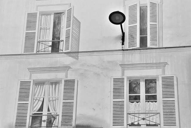 Four windows and a street lamp