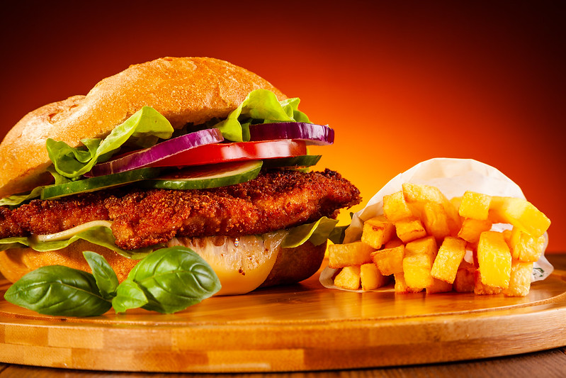 chicken fried pork sandwich with fries