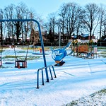 Snow covered playground at Haslam Park, Preston