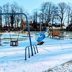 Snow covered playground at Haslam Park, Preston