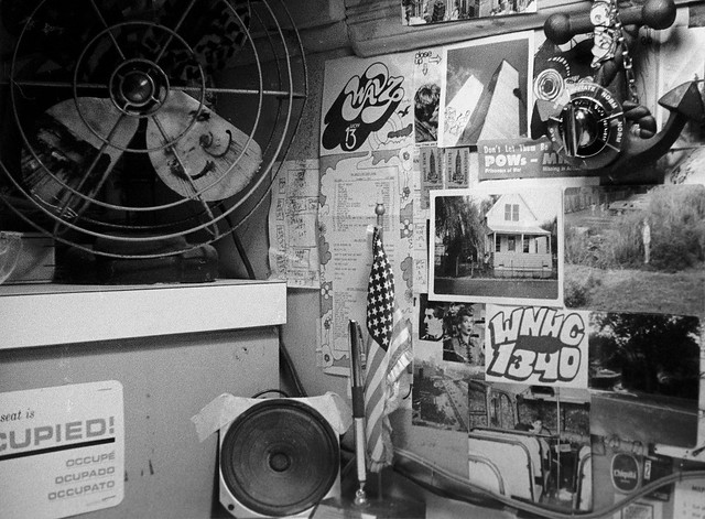 Late night view of my room's desk showing posters for WAVZ and WNHC radio, a photo of the World Trade Center, I Love Lucy, and many other teenage fascinations. Some of them have links to other photos on Flickr. Milford Connecticut. Feb 1973.