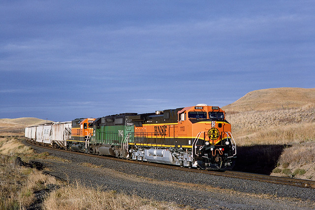 BNSF 1110 + BN 7842 + BNSF 7312 at Cheyney WA with westbound Grain loads on 24 September 1999