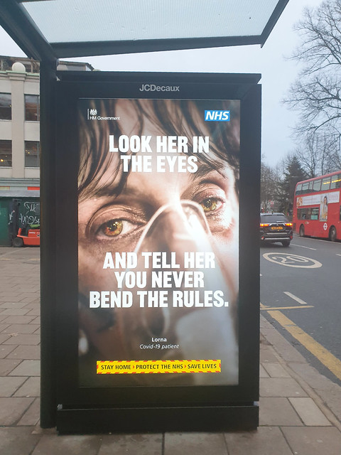 Look into my eyes  bus stop signage Covid19 Year Two