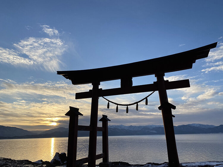 A Torii gate stands overlooking the great Lake Tazawa.