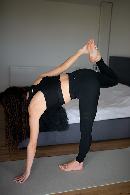 Woman practicing yoga in the morning.