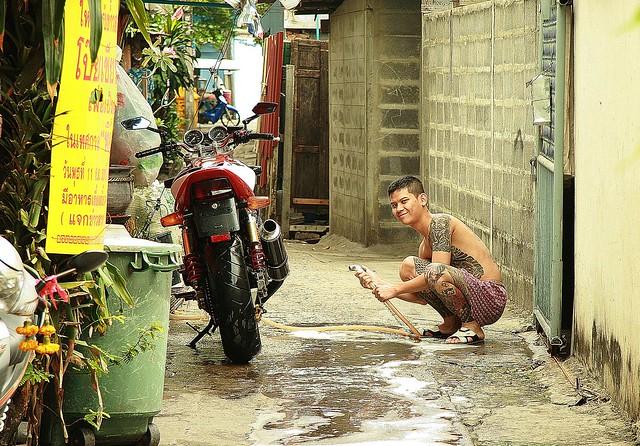 washing his motorcycle