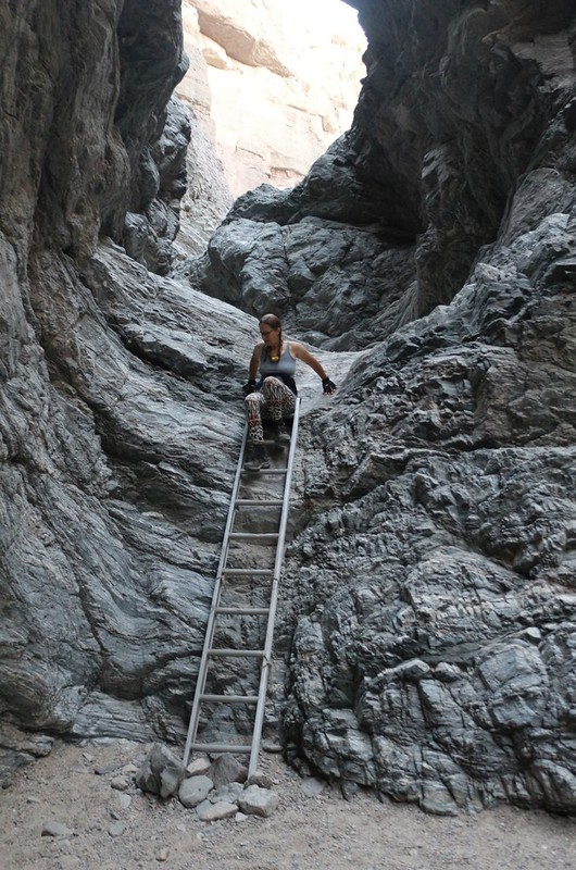 Vicki carefully descending on the lower of two ladders in Painted Canyon