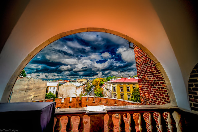 View down the Straszewskiego St of Krakow Old Town from Wawel Royal Castle from inside the round outer wall structure, Poland.  775-Edita