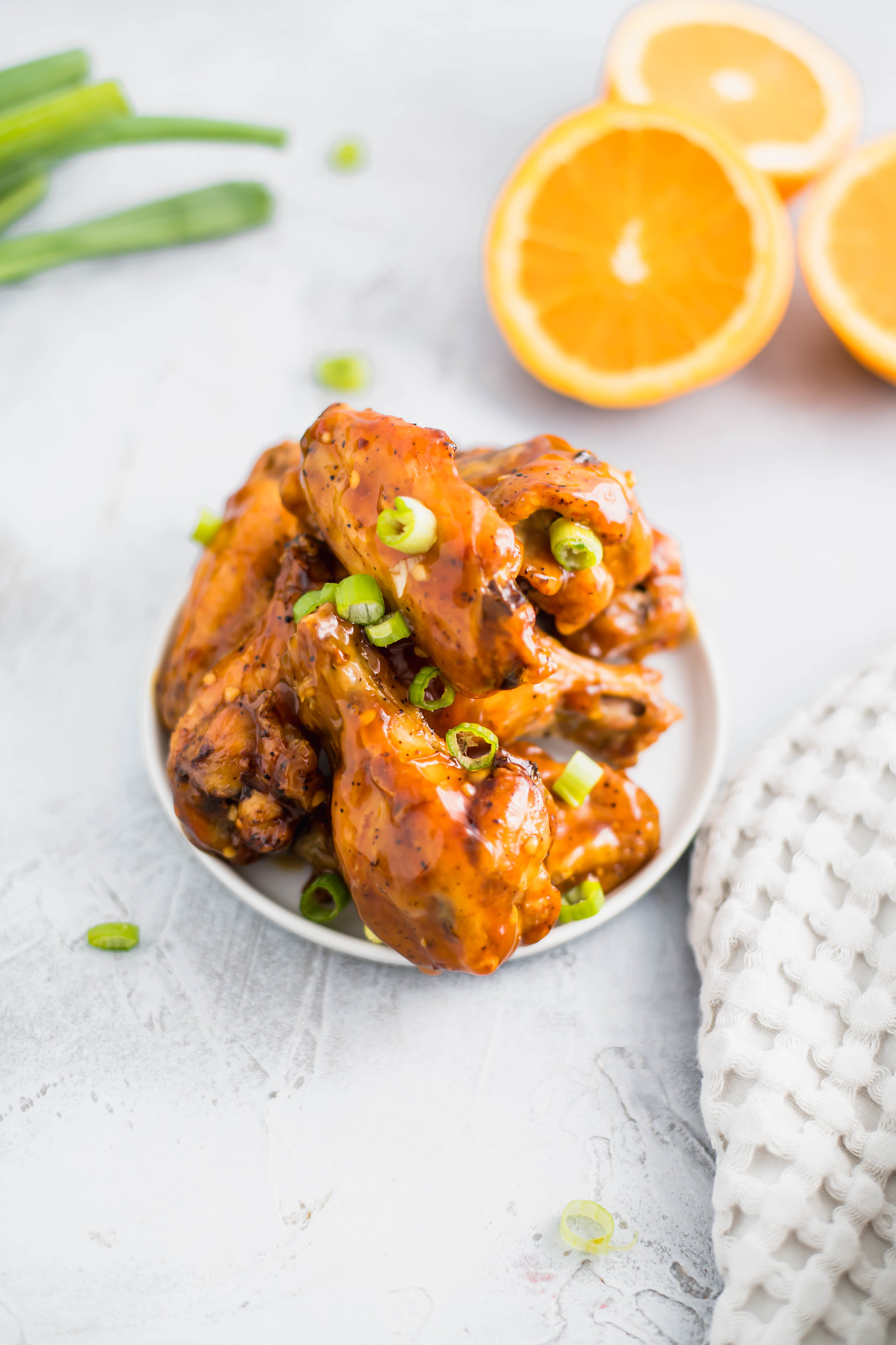 Need a fun and flavorful chicken wing recipe for the Super Bowl? These Orange Chicken Wings are packed with bright, spicy flavor.