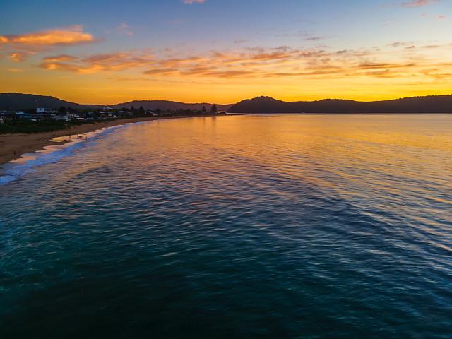 Summer aerial sunrise seascape with high cloud