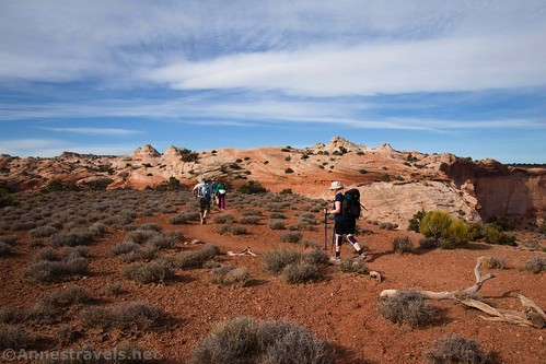 Hiking back up the red-dirt bench, Lathrop Trail, Canyonlands National Park, Utah