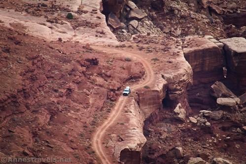 A truck (probably belonging to the National Park Service) on the White Rim Road above Lower Lathrop Canyon, Canyonlands National Park, Utah