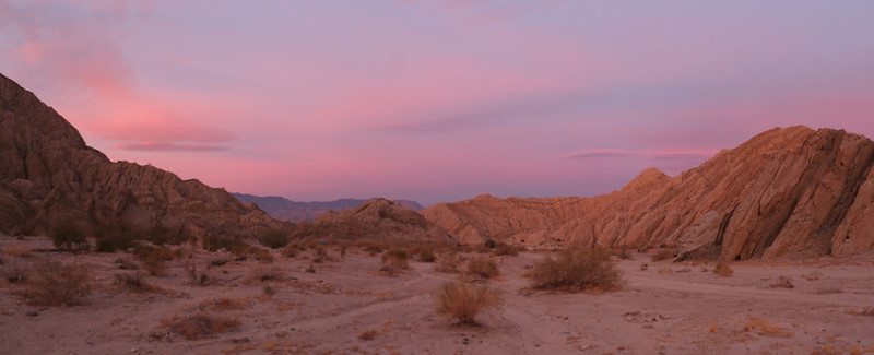 Panorama at dawn with colorful clouds from our campsite along Painted Canyon Road