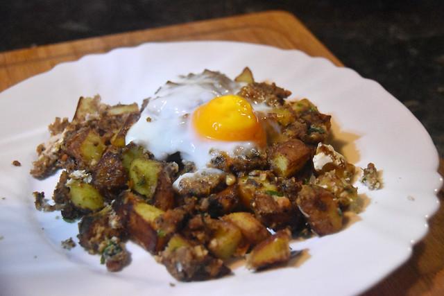 Haggis, garlic potatoes, and baked egg