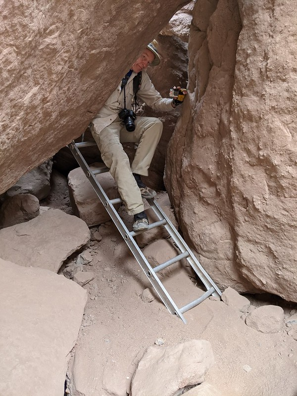 Me, as I come down the final ladder under some huge blocks of sandstone at the mouth of Ladder Canyon
