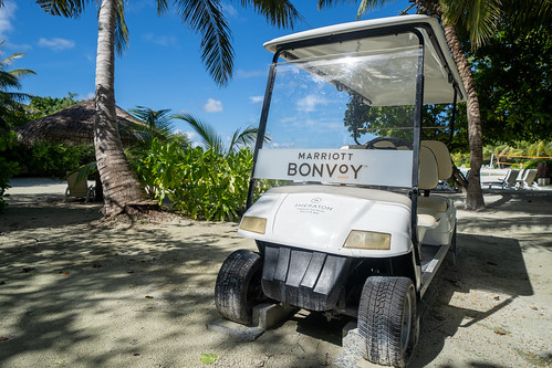 A Marriott Bonvoy golf cart waits is available to transport resort guests around the property at the Sheraton Full Moon Resort, North Male Atoll, Maldives. From Marriott Points Guide For Beginners