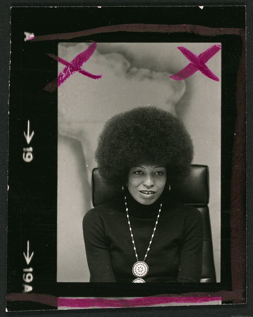 "[Angela Davis, half-length portrait, with ""x"" markings that indicate the photographer's or editor's selection of a photo for printing] (LOC)"