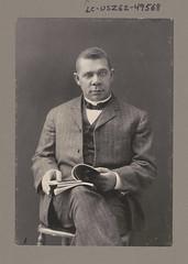 [Booker T. Washington sitting and holding books] (LOC)