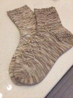 Rosemary finished this pair of Tanis Fibre Arts Business/Casual socks (free pattern) knit using Lichen and Lace sock yarn in Linen.