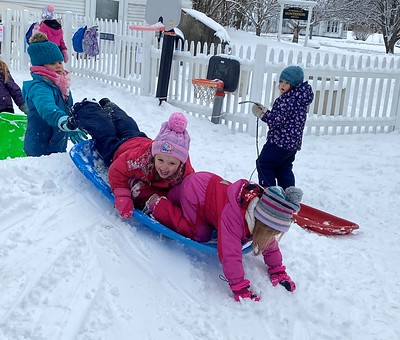 happy sledding girls