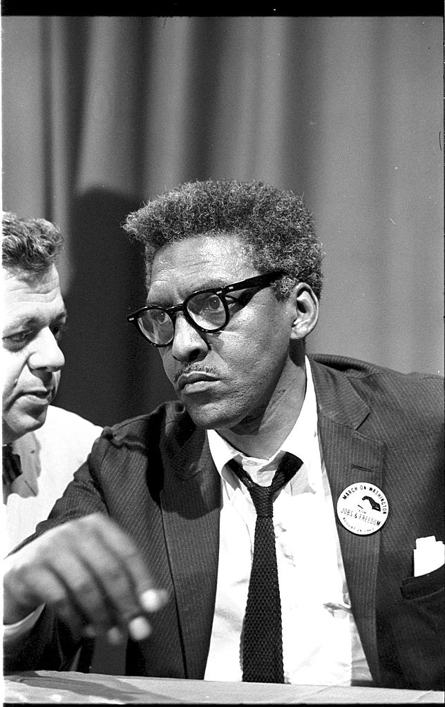 [Bayard Rustin at news briefing on the Civil Rights March on Washington in the Statler Hotel, half-length portrait, seated at table] (LOC)