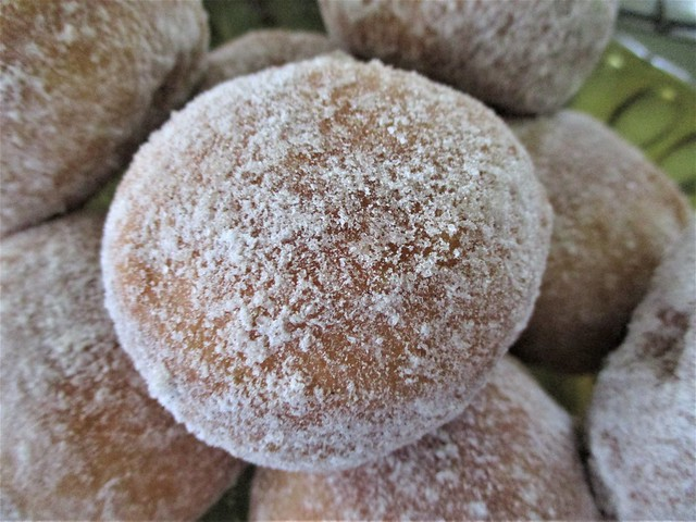 Bombolone, coated with icing sugar & cinnamon