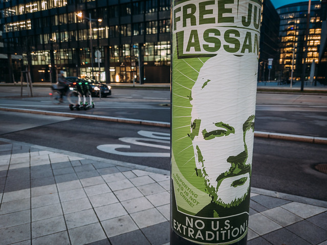 """Close-up of a poster on a pole with a message """"Free Julian Assange"""""""