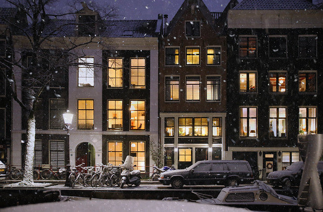 Enchanting warm lights on a snowy winter evening in Amsterdam