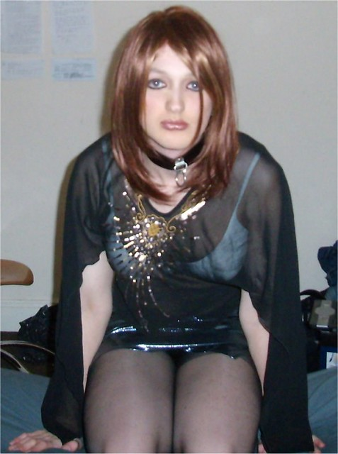 in a sheer top and a skimpy skirt