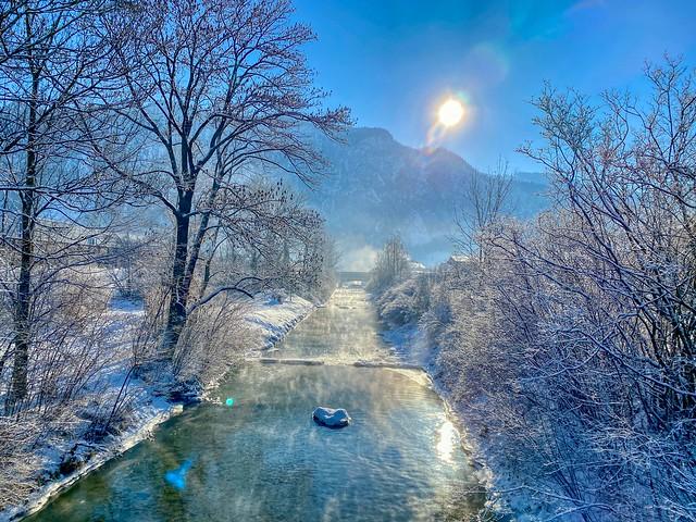 Kieferbach creek with rising mist in Kiefersfelden in Bavaria, Germany