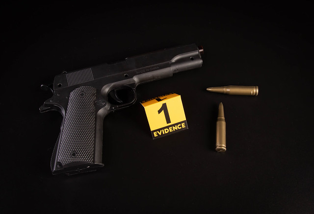 Crime scene concept with a gun and evidence marker