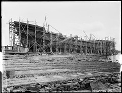 'Braeside' or 'Burnside' under construction, Kidman & Mayoh, shipbuilders, Kissing Point Park, Ryde, Sydney, c. 1920, Arthur Ernest Foster