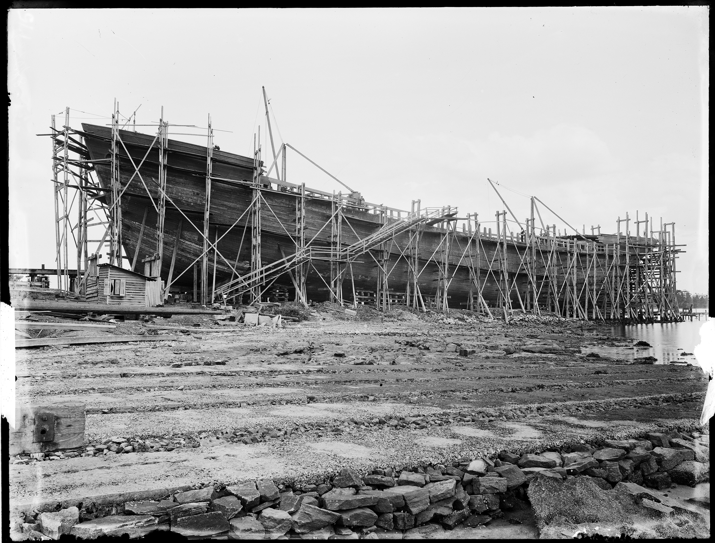 'Braeside' or 'Burnside' under construction, Kidman & Mayoh, shipbuilders, Kissing Point Park, Ryde, Sydney, c. 1920, Arthur Ernest Foster