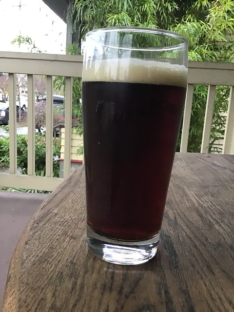 T-1000 Eisbock from Oregon City brewing, in glass, on table outside