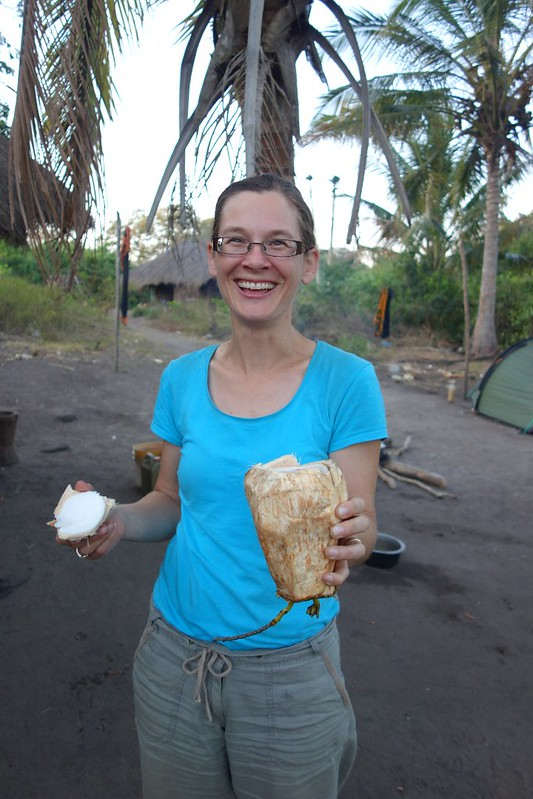 Nichole Gross-Camp holding a rock and coconut flesh