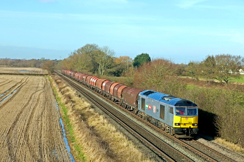 DB Cargo 60074 'Luke' in Puma Energy livery passes Barrow upon Trent on 1.2.21 with 6E01 1002 Wolverhampton Steel Term to Toton Up Sidings empty steel carriers