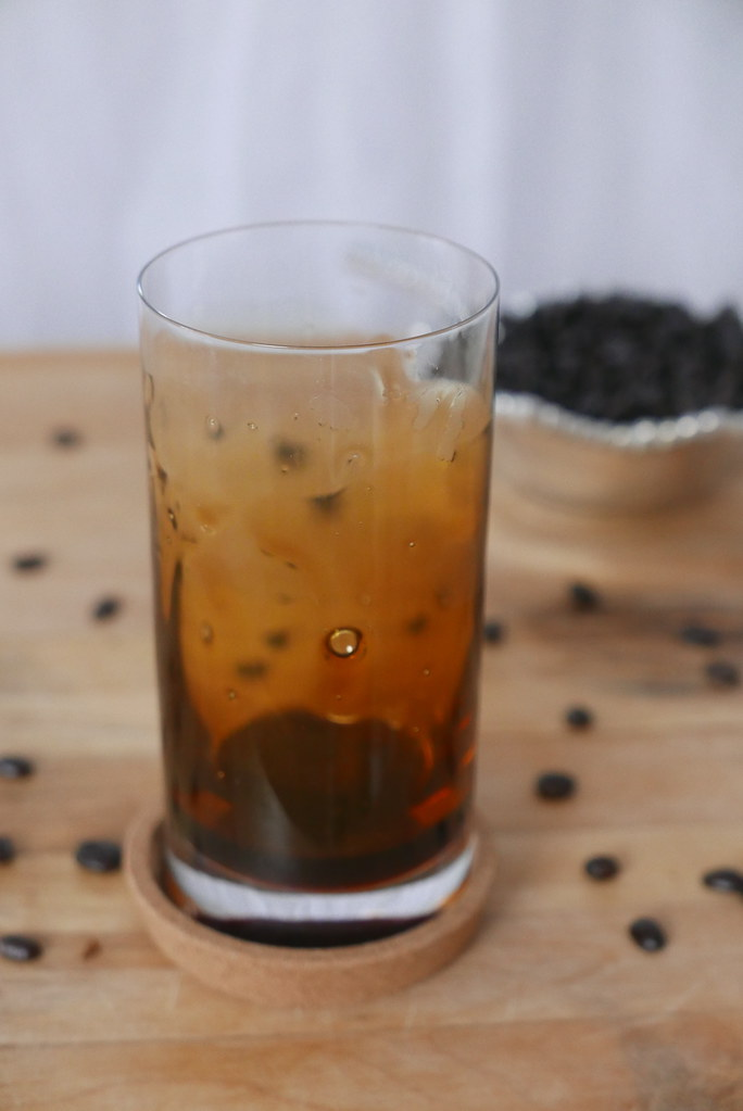 A photo of a glass with burnt brown sugar syrup coating the sides.