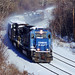 capwell posted a photo:	A Conrail SD70 leads a snow-covered westbound manifest past Mack Truck on the west side of Allentown on a frigid winter day in December of 2000