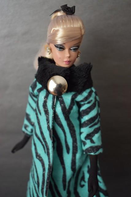 Cocktail Dress Silkstone wearing a Dangerous Dames Coat