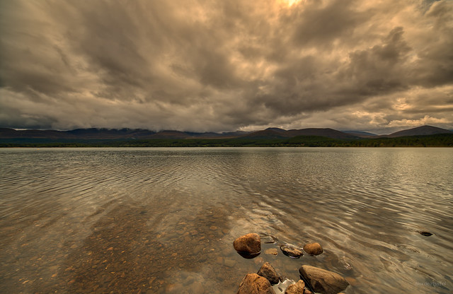A family of rocks going for a swim at Loch Morlich, Scotland.