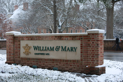 The William & Mary sign at Confusion Corner is surrounded by its first blanket of snow.