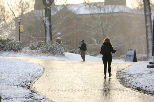 W&M students bundle up while walking on campus after the recent snow.
